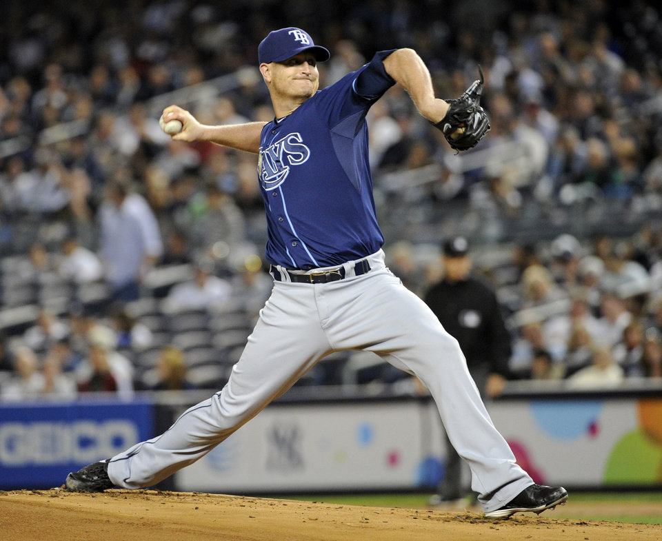 Photo - Tampa Bay Rays pitcher Alex Cobb delivers the ball to the Tampa Bay Rays during the first inning of a baseball game Thursday, Sept. 26, 2013, at Yankee Stadium in New York. (AP Photo/Bill Kostroun)