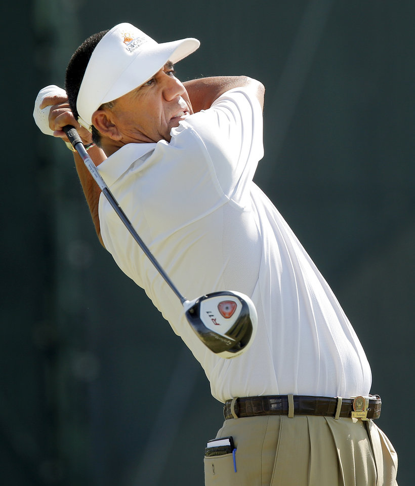 Photo - Esteban Toledo hits a tee shot on No. 18 during practice rounds for the U.S. Senior Open golf tournament at Oak Tree National in Edmond, Okla., Monday, July 7, 2014. Photo by Nate Billings, The Oklahoman