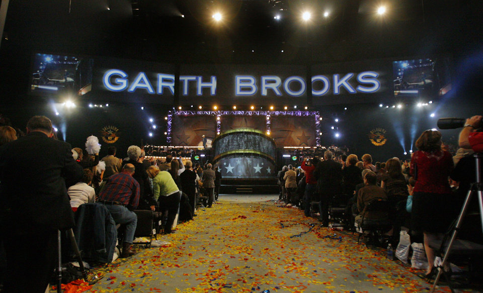 Photo - Garth Brooks takes the stage during the Centennial Spectacular to celebrate the 100th birthday of the State of Oklahoma at the Ford Center on Friday, Nov. 16, 2007, in Oklahoma City, Okla. Photo By CHRIS LANDSBERGER, The Oklahoman