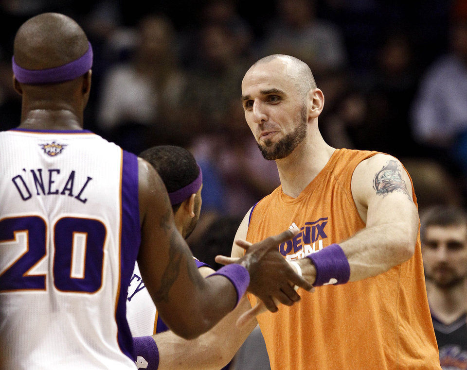 Photo -   Phoenix Suns' Jermaine O'Neal (20) gets to celebrate his score against the Portland Trail Blazers with teammate Marcin Gortat, of Poland, during the first half of an NBA basketball game, Wednesday, Nov. 21, 2012, in Phoenix. (AP Photo/Ross D. Franklin)
