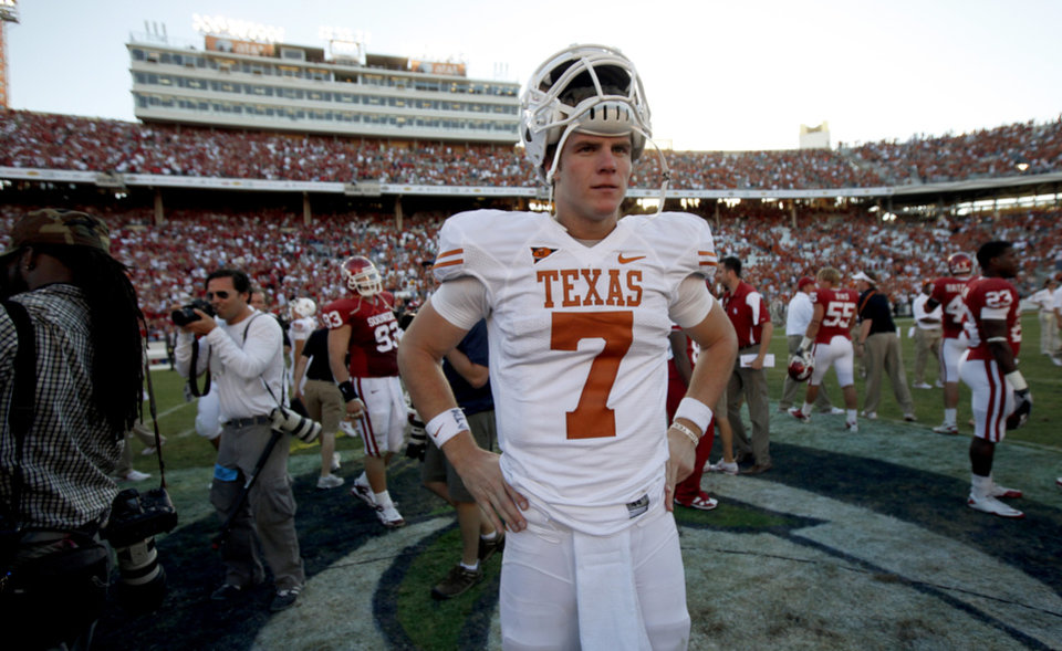 Garrett Gilbert pauses after the Red River Rivalry college football game between the University of Oklahoma Sooners (OU) and the University of Texas Longhorns (UT) at the Cotton Bowl on Saturday, Oct. 2, 2010, in Dallas, Texas.  OU defeated Texas 28-20.  Photo by Bryan Terry, The Oklahoman ORG