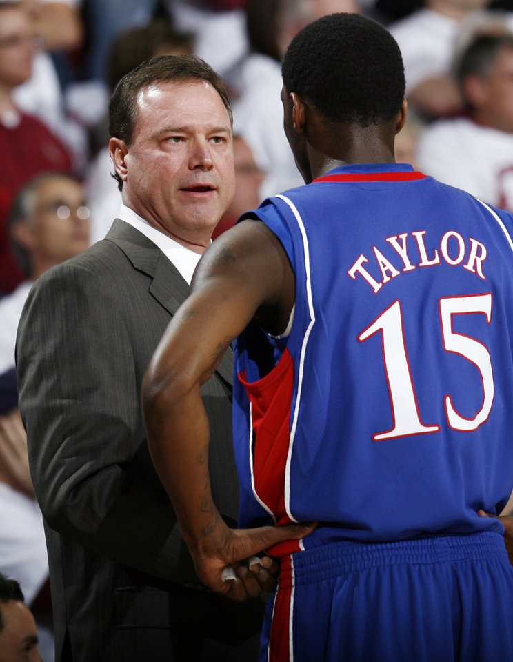 KU head coach Bill Self talks with Tyshawn Taylor (15) in the first half of the men's college basketball game between Kansas and Oklahoma at the Lloyd Noble Center in Norman, Okla., Monday, February 23, 2009. BY NATE BILLINGS, THE OKLAHOMAN
