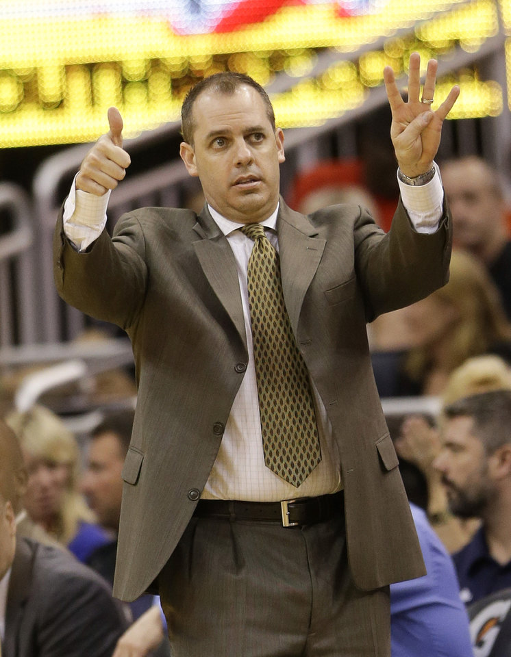 Photo - Indiana Pacers head coach Frank Vogel directs his players against the Orlando Magic during the first half of an NBA basketball game in Orlando, Fla., Wednesday, April 16, 2014. (AP Photo/John Raoux)