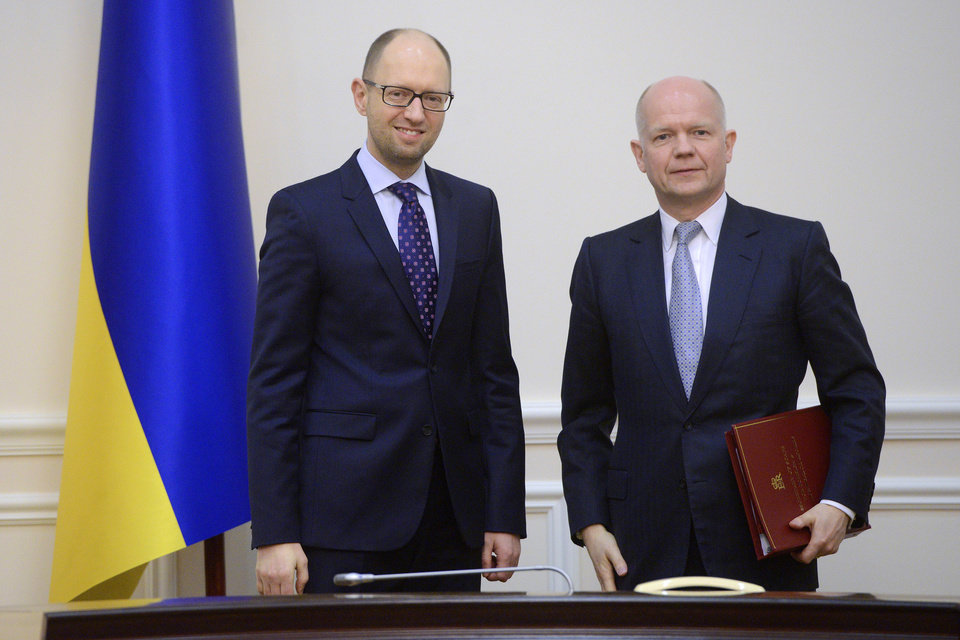 Photo - Ukrainian Prime Minister Arseniy Yatsenyuk, left, and British Foreign Secretary William Hague pose for a photograph prior to their meeting in Kiev, Ukraine, Monday, March 3, 2014. Pro-Russian troops took over a ferry terminal on the easternmost tip of Crimea close to Russia on Monday, exacerbating fears that Moscow is planning to bring even more troops into this strategic Black Sea region. (AP Photo/Andrew Kravchenko, Pool)