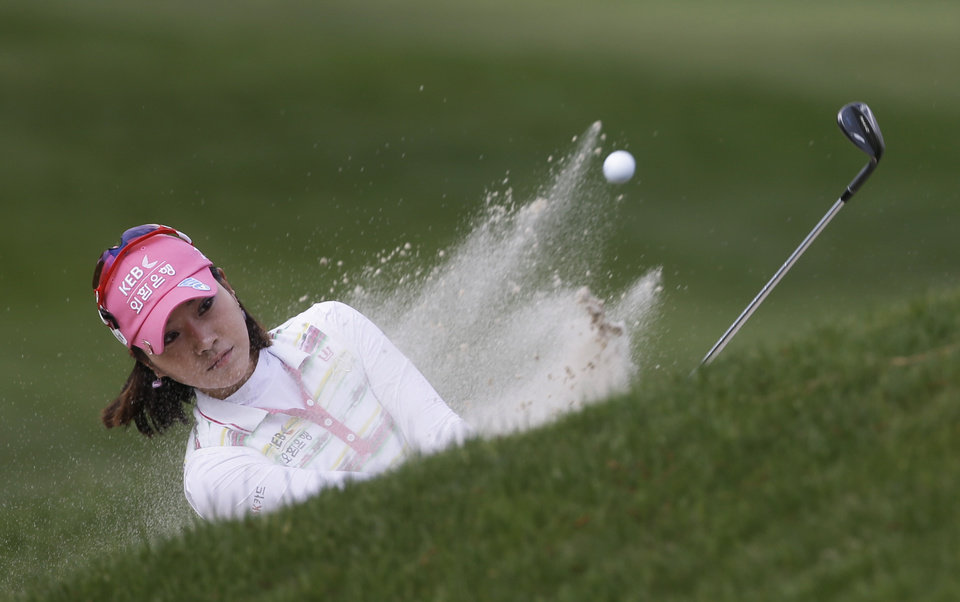 Photo - Hee Young Park, of South Korea, hits out of the bunker on the ninth green during the final round of the Kingsmill Championship golf tournament at the Kingsmill resort  in Williamsburg, Va., Sunday, May 18, 2014.   (AP Photo/Steve Helber)