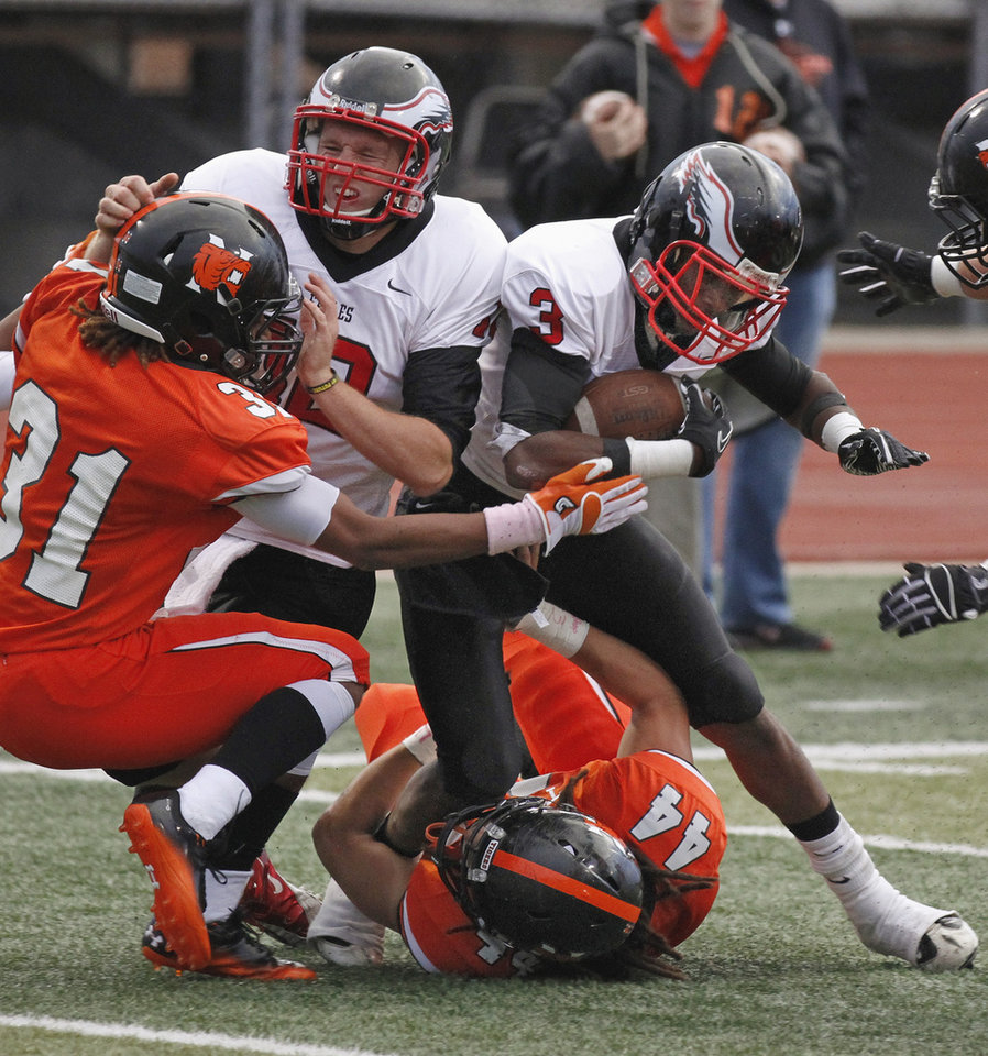 Del City's Corey Lawrence (3) turns a loss into a gain, reversing field and carrying inside the ten as the Norman High School Tigers play the Del City Eagles on Thursday, September 15, 2011, in Norman, Okla.  His blocker is quarterback Jonathon McBride (12). Photo by Steve Sisney, The Oklahoman