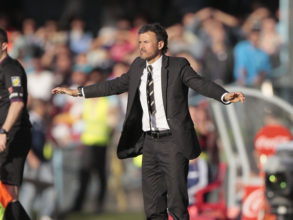Photo - In this photo taken on Sunday, May 11, 2014, Celta's coach Luis Enrique gestures during a Spanish La Liga soccer match at the Balaidos stadium in Vigo, Spain.  Barcelona hired Luis Enrique as its new coach on Monday, hoping the former player can help restore the club's recent success following its first season in six years without a major trophy. (AP Photo/Lalo R. Villar)
