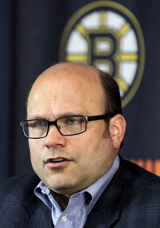 Photo -   Boston Bruins general manager Peter Chiarelli speaks to reporters at TD Garden in Boston, Friday, April 27, 2012, about their loss to the Washington Capitals in Game 7 and the Bruins' elimination from the Stanley Cup hockey playoffs. (AP Photo/Elise Amendola)