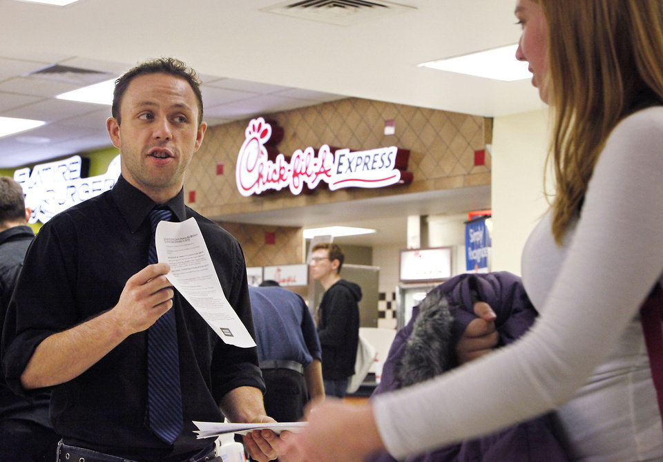 University of Central Oklahoma student Kyle Brower hands out information about Chick-fil-A corporate policies Tuesday at UCO's Nigh University Center. Photo By David McDaniel, The Oklahoman <strong>David McDaniel</strong>