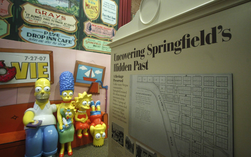 Photo -   The Simpsons Couch is on display at the Springfield Museum Tuesday, April 10, 2012, in Springfield, Ore. One of the best-kept secrets in television history has been revealed, with