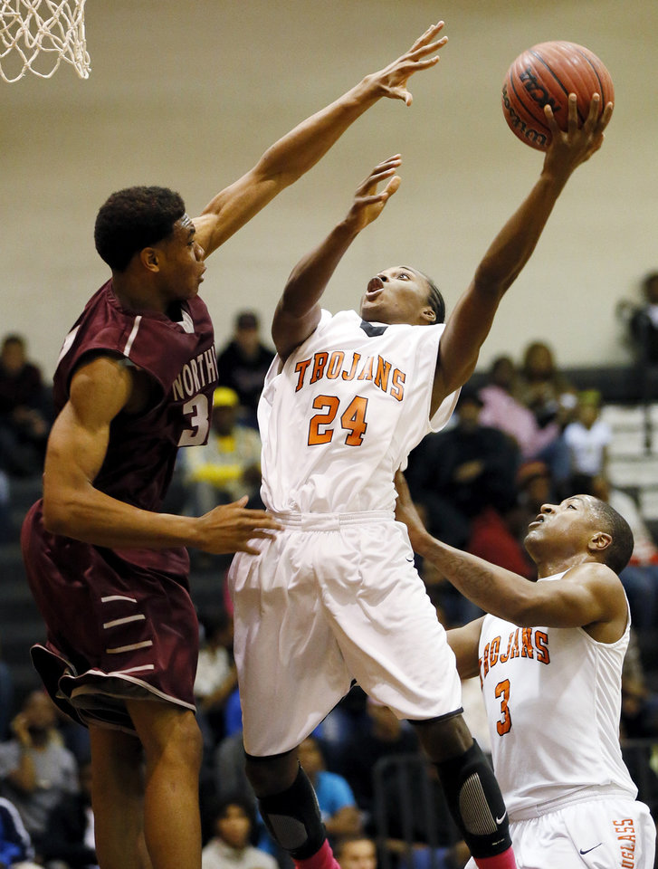 Photo - James Grimes (24) of Douglass shoots in front of Dior Smiley (3) against Deshawn Watson (32) of Northeast during a boys high school basketball game between Douglass and Northeast at Douglass High School in Oklahoma City, Friday, Feb. 8, 2013. Photo by Nate Billings, The Oklahoman