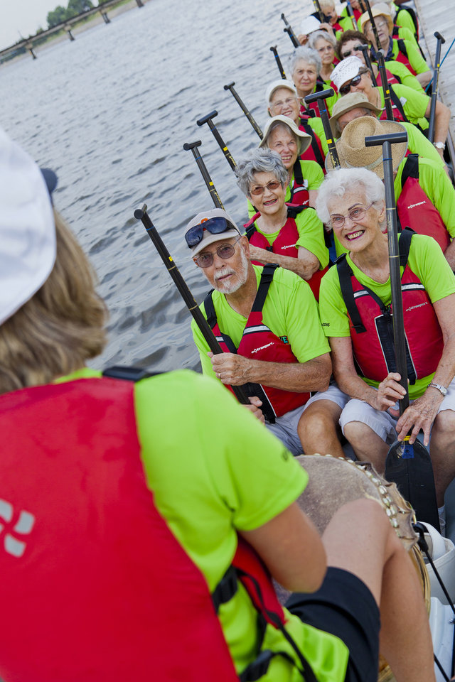 Photo -  Letha Long (front row) is all smiles as the Golden Dragons start rowing practice. Photo provided by Debbie Miller.