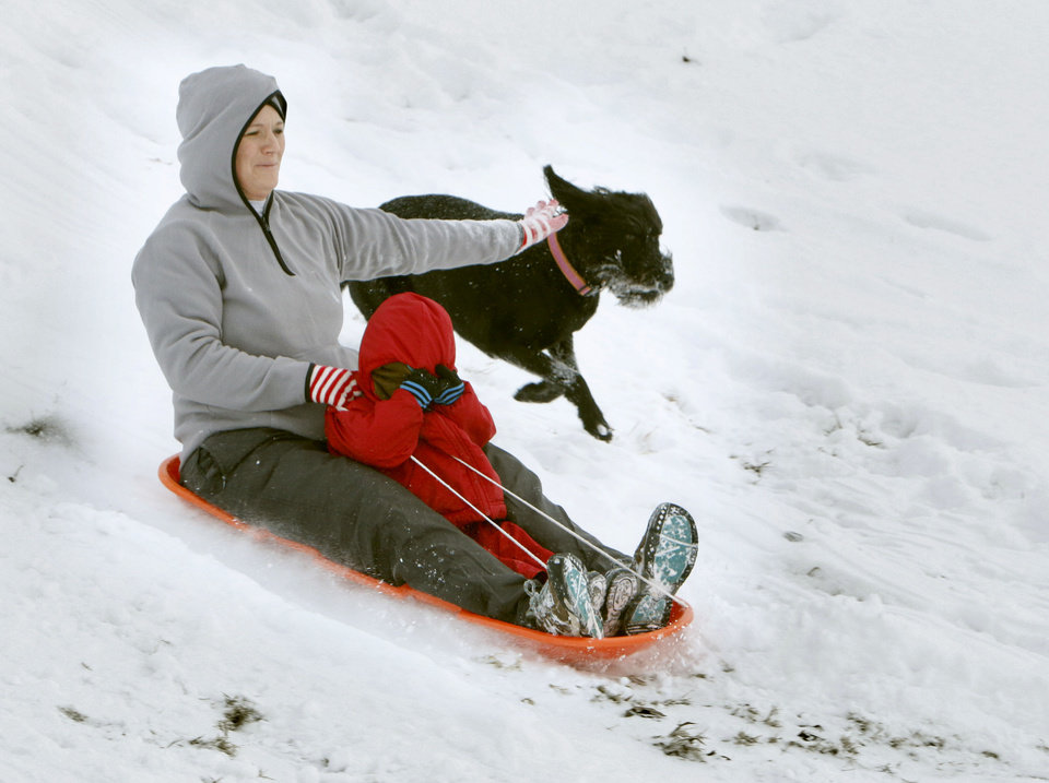 "Karen and Kemper Denton sled alongside ""LuLu Belle"" at Will Rogers Park in Oklahoma City, OK, Friday, December 6, 2013,  Photo by Paul Hellstern, The Oklahoman"