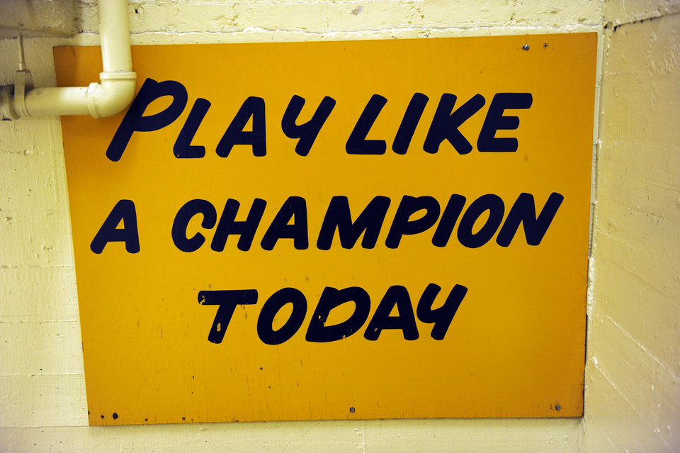 Photo - The hallway between the locker room and the field at Notre Dame stadium features a sign