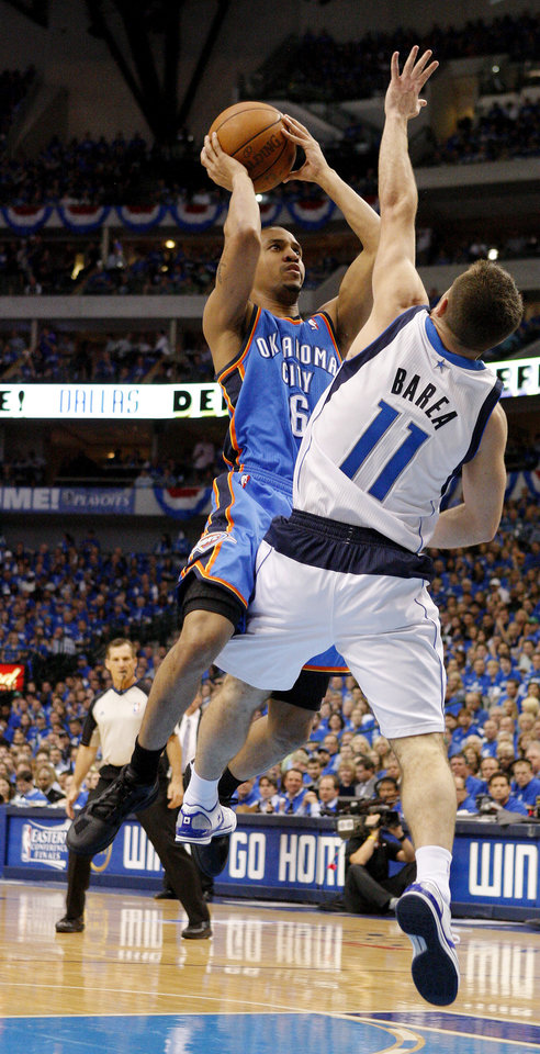 Oklahoma City's Eric Maynor (6) shoots the ball over Jose Juan Barea (11) of Dallas during game 2 of the Western Conference Finals in the NBA basketball playoffs between the Dallas Mavericks and the Oklahoma City Thunder at American Airlines Center in Dallas, Thursday, May 19, 2011. Photo by Bryan Terry, The Oklahoman