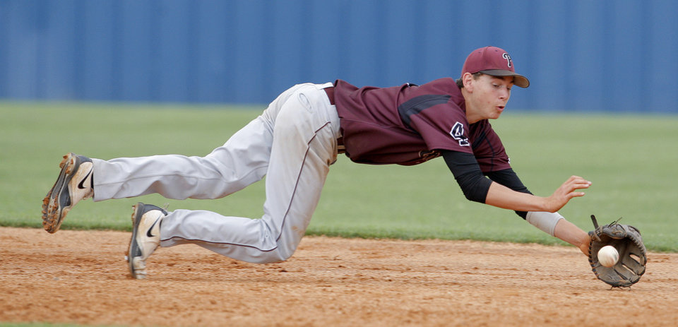 Photo - HIGH SCHOOL BASEBALL / STATE TOURNAMENT: Pioneer's Brett McNaughton makes a diving stop during the high school Class A baseball playoff game between Rattan and Pioneer at Dolese Park in Oklahoma City, Friday, May 4, 2012. Photo by Sarah Phipps, The Oklahoman