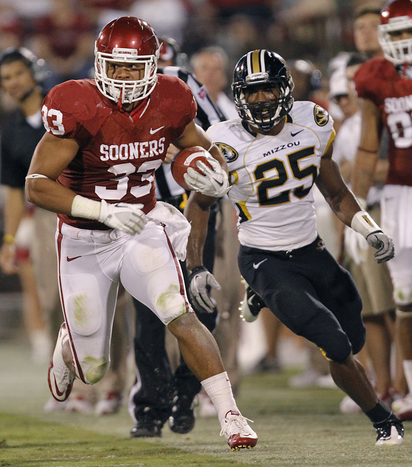 Photo - Oklahoma's Trey Millard (33) runs past Missouri's Zavier Gooden (25) during the college football game between the University of Oklahoma Sooners (OU) and the University of Missouri Tigers (MU) at the Gaylord Family-Memorial Stadium on Saturday, Sept. 24, 2011, in Norman, Okla. Photo by Chris Landsberger, The Oklahoman