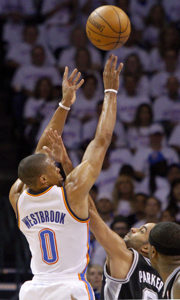 Oklahoma City's Russell Westbrook (0) shoots the ball over San Antonio's Tony Parker (9) during Game 6 of the Western Conference Finals between the Oklahoma City Thunder and the San Antonio Spurs in the NBA playoffs at the Chesapeake Energy Arena in Oklahoma City, Wednesday, June 6, 2012. Photo by Bryan Terry, The Oklahoman