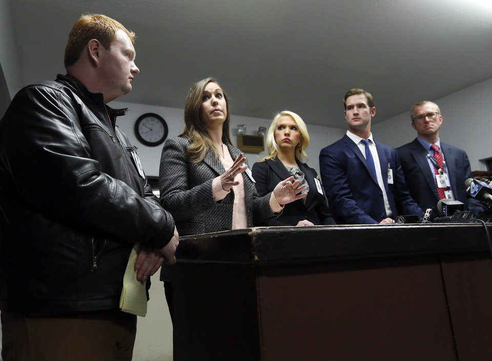 Photo - Media witnesses, from left, Parker Perry, McAlester News-Capital; Tess Maune, KOTV; Abby Broyles, KFOR; Morgan Chesky, KOCO; and Sean Murphy, Associated Press, speak to the media after witnessing the execution by lethal injection of Charles Warner at the Oklahoma State Penitentiary in McAlester, Okla., Thursday, Jan. 15, 2015. Charles Warner is the first inmate to be executed in Oklahoma since the bungled execution of Clayton Lockett on April 29, 2014. Photo by Nate Billings, The Oklahoman