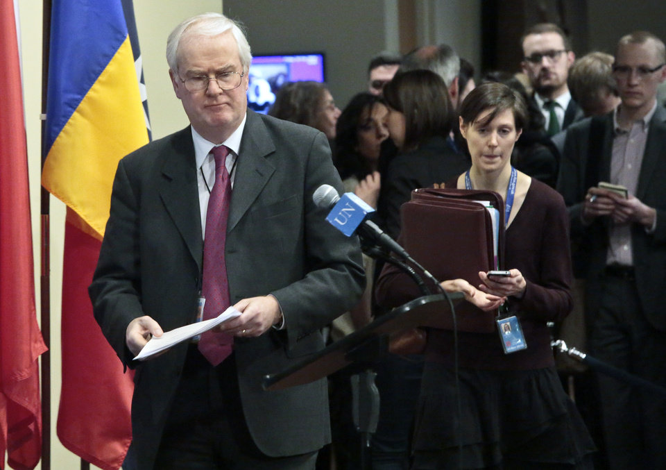 Photo - United Kingdom's U.N. Ambassador Mark Lyall Grant, left, arrives for a news conference after a private U.N. Security Council meeting on the Ukraine, Friday, Feb. 28, 2014, at United Nation headquarters. (AP Photo/Bebeto Matthews)
