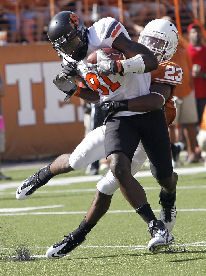Photo - Oklahoma State's Justin Blackmon (81) gets free from Texas' Carrington Byndom (23) during first half of a college football game between the Oklahoma State University Cowboys (OSU) and the University of Texas Longhorns (UT) at Darrell K Royal-Texas Memorial Stadium in Austin, Texas, Saturday, Oct. 15, 2011. Photo by Sarah Phipps, The Oklahoman