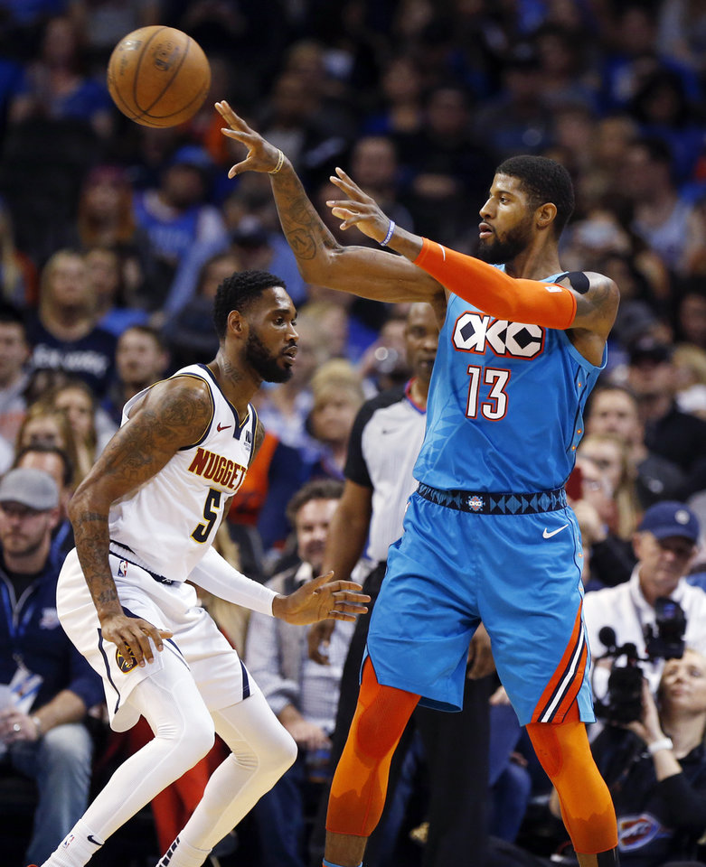 Photo - Oklahoma City's Paul George (13) passes around Denver's Will Barton (5) in the third quarter during an NBA basketball game between the Denver Nuggets and the Oklahoma City Thunder at Chesapeake Energy Arena in Oklahoma City, Friday, March 29, 2019. Denver won 115-105. Photo by Nate Billings, The Oklahoman