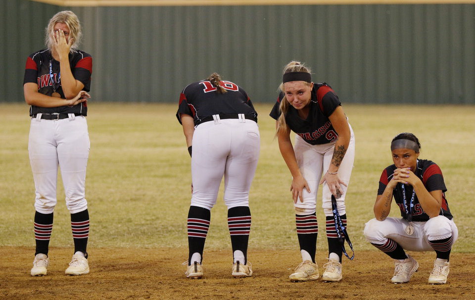 Photo - Owasso players react to their loss during the 6A Fast Pitch Championship game between Edmond Memorial and Owasso at the Ball Fields at Firelake in Shawnee, Saturday, October 19, 2019. [Doug Hoke/The Oklahoman]