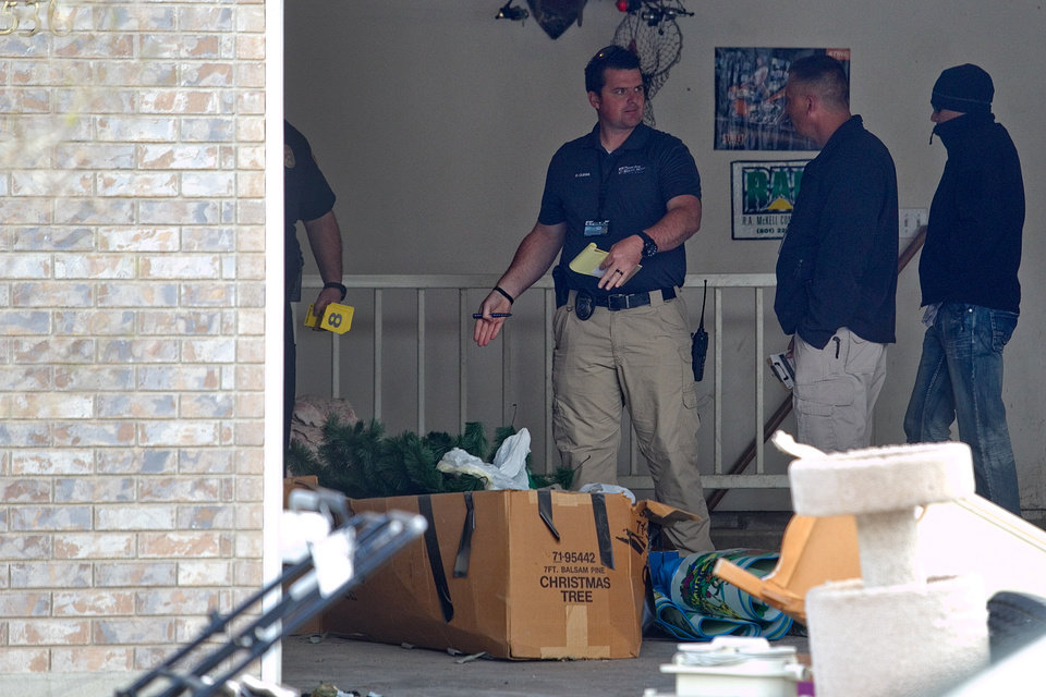 Photo - Authorities investigate a crime scene at a house in Pleasant Grove, Utah, Sunday, April 13, 2014. According to the Pleasant Grove Police Department, seven dead infants were found in the former home of Megan Huntsman, 39. Huntsman was booked into jail on six counts of murder. (AP Photo/Daily Herald, Mark Johnston)
