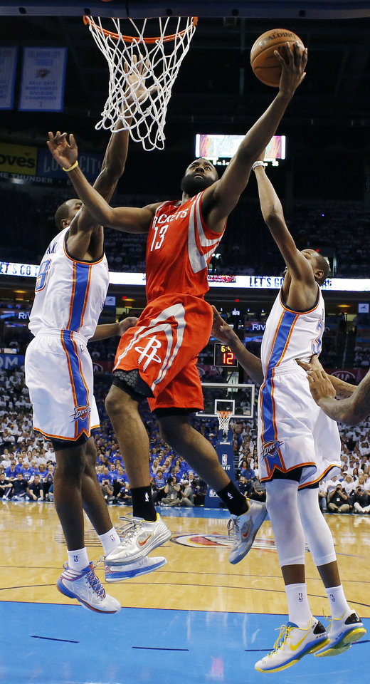 Photo - Houston's James Harden (13) takes a shot between Oklahoma City's Serge Ibaka (9) and Kevin Durant (35) during Game 2 in the first round of the NBA playoffs between the Oklahoma City Thunder and the Houston Rockets at Chesapeake Energy Arena in Oklahoma City, Wednesday, April 24, 2013. Oklahoma City won, 105-102. Photo by Nate Billings, The Oklahoman