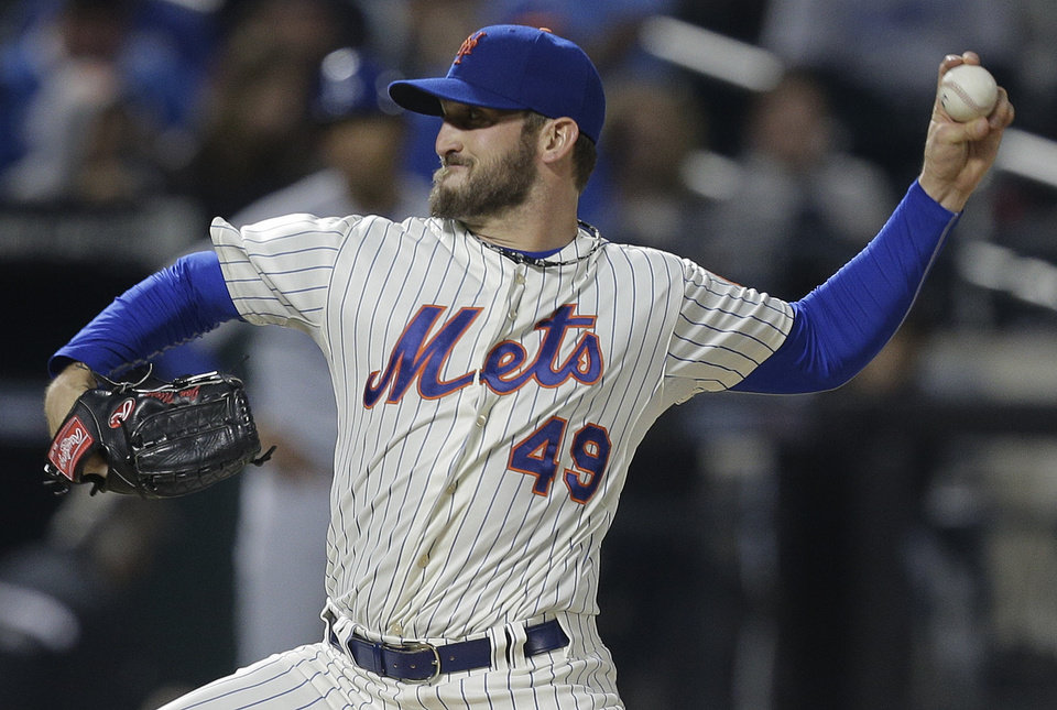 Photo - New York Mets starting pitcher Jonathon Niese  delivers against the Los Angeles Dodgers during the fourth inning of a baseball game, Thursday, May 22, 2014, in New York. (AP Photo/Julie Jacobson)