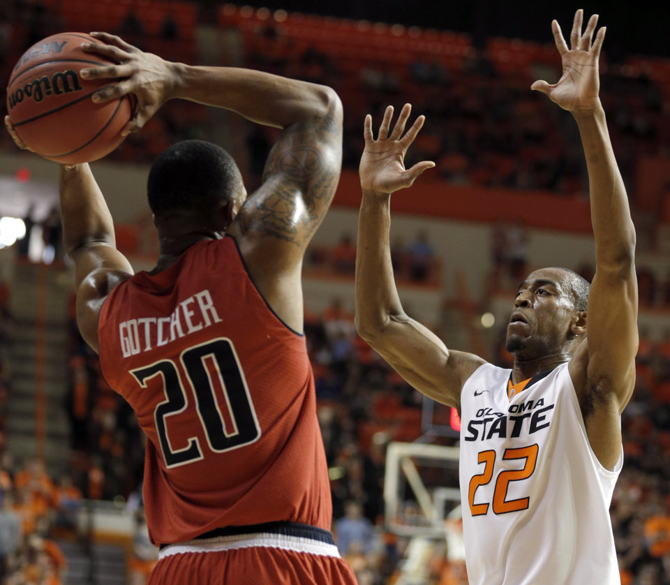 Photo - Oklahoma State's Markel Brown (22) pressures Toddrick Gotcher (20) during the men's college basketball game between Oklahoma State and Texas Tech at Gallagher-Iba Arena in Stillwater, Okla., Saturday, Feb. 22, 2014. OSU won 84-62. 