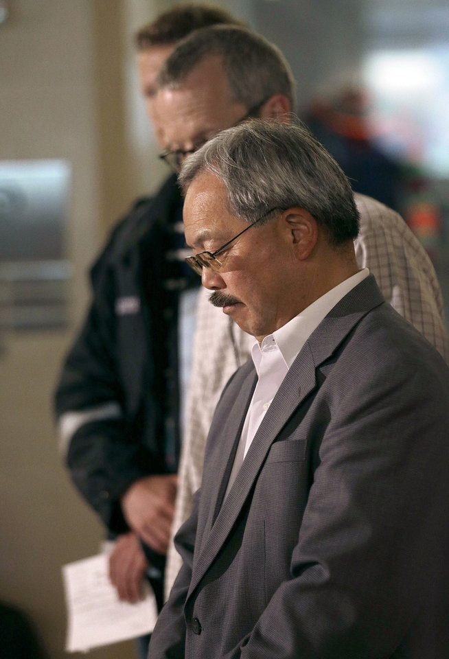 Photo - San Francisco Mayor Ed Lee listens to speakers at a news conference after Asiana Flight 214 crashed at San Francisco International Airport in San Francisco, Saturday, July 6, 2013. (AP Photo/Jeff Chiu)