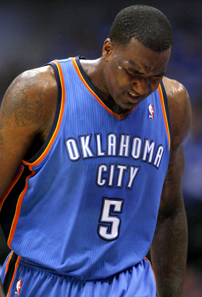 Oklahoma City's Kendrick Perkins (5) grimaces in pain during Game 4 of the first round in the NBA playoffs between the Oklahoma City Thunder and the Dallas Mavericks at American Airlines Center in Dallas, Saturday, May 5, 2012. Oklahoma City won 103-97.  Photo by Bryan Terry, The Oklahoman