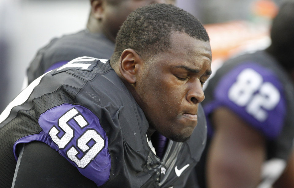 Photo -   TCU offensive tackle Tayo Fabuluje (59) sits on the bench in the final minute of an NCAA college football game against Iowa State, Saturday, Oct. 6, 2012, in Fort Worth, Texas. Iowa State won 37-23. (AP Photo/LM Otero)