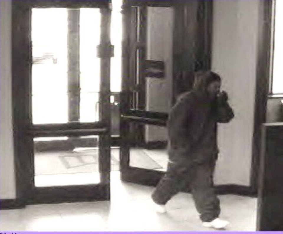 A robber enters MidFirst Bank, 810 SW 44, about 9:05 a.m. Friday. He showed a revolver and left with an undisclosed amount of cash. PHOTO PROVIDED
