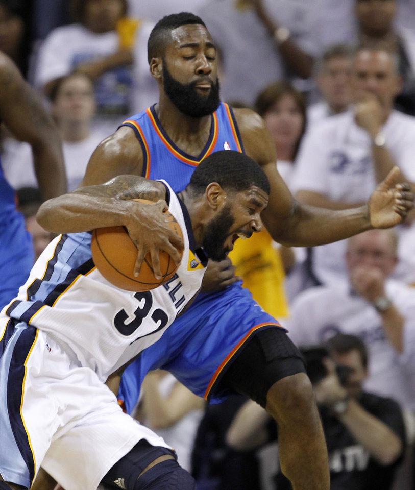 Memphis Grizzlies guard O. J. Mayo (32) drives against Oklahoma City Thunder guard James Harden during the first half of Game 6 of a second-round NBA basketball playoff series on Friday, May 13, 2011, in Memphis, Tenn. (AP Photo/Lance Murphey)