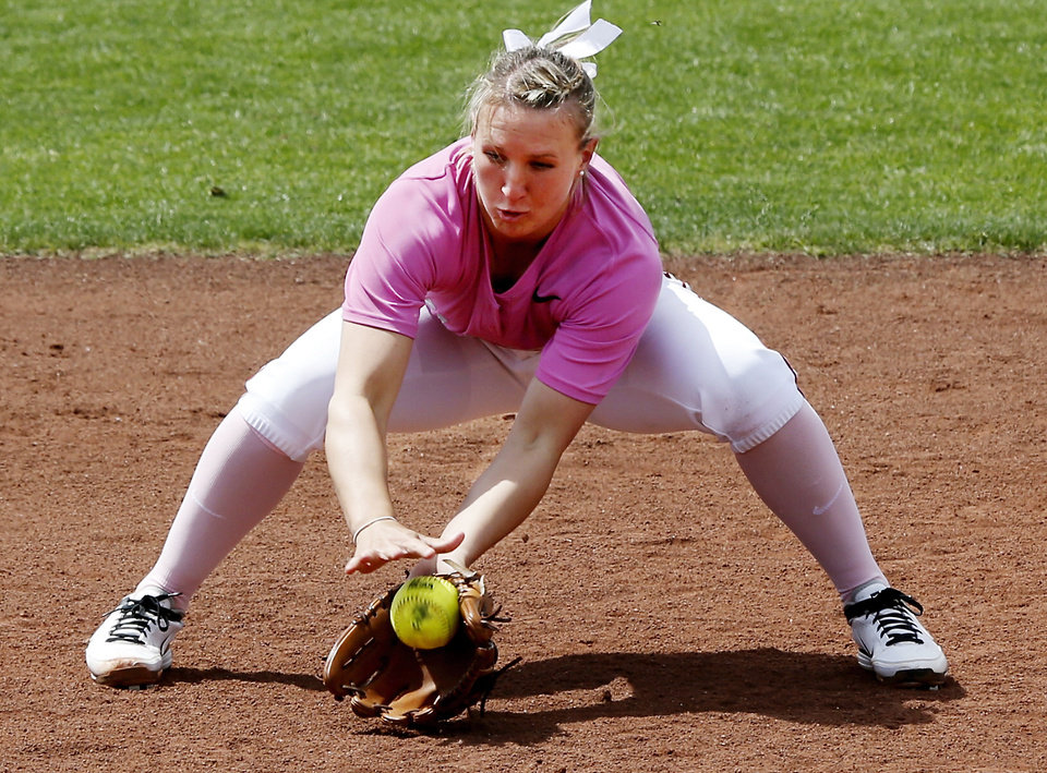 Shelby Pendley, Sooner shortstop, grabs a ground ball and makes a play at second base as the University of Oklahoma (OU) Sooners play the Baylor Bears in NCAA college softball at Marita Hines Field on Saturday, April 6, 2013  in Norman, Okla. Photo by Steve Sisney, The Oklahoman