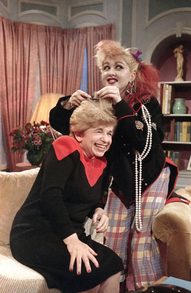 Photo -   FILE - In this Jan. 17, 1985 file photo, sex therapist Dr. Ruth Westheimer laughs as musician Cyndi Lauper does her hair up in
