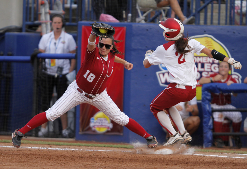 Photo - Oklahoma's Brianna Turang (2) runs into first past Alabama's Cassie Reilly-Boccia (18) during a Women's College World Series softball game between OU and Alabama at ASA Hall of Fame Stadium in Oklahoma City, Tuesday, June 5, 2012.  Photo by Garett Fisbeck, The Oklahoman