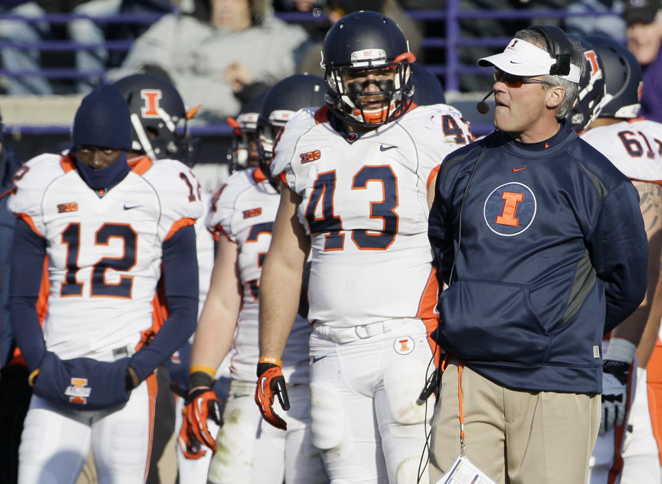 Photo -   Illinois head coach Tim Beckman, right, reacts as he watches his team during the second half of an NCAA college football game against Northwestern in Evanston, Ill., Saturday, Nov. 24, 2012. Northwestern won 50-14. (AP Photo/Nam Y. Huh)