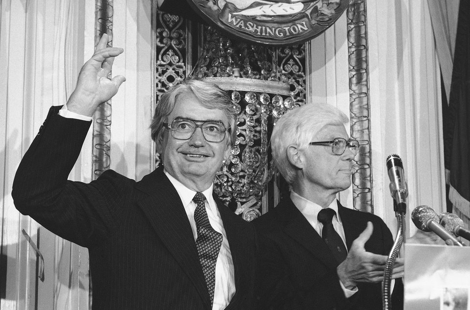 Photo - FILE- In this Aug. 25, 1980 file photo, Wisconsin Gov. Patrick J. Lucey, left, waves to the audience at the National Press Club in Washington after Independent presidential candidate John B. Anderson of Illinois, right, announced Lucey would be his vice presidential running mate. Lucey, a hard-nosed Democratic politician who later became ambassador to Mexico, died Saturday, May 10, 2014. He was 96. (AP Photo/File)