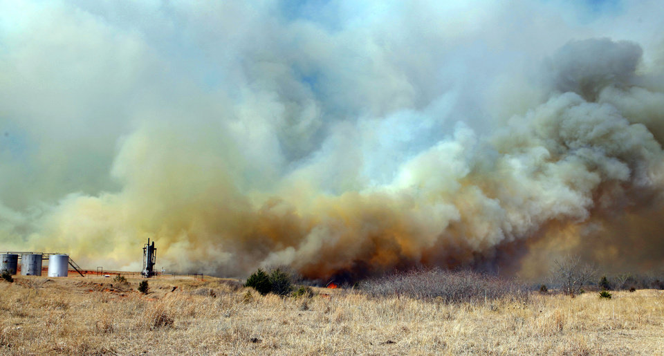 Photo - A large grass fire rages on Friday, March 11, 2011, in Goldsby, Okla. Photo by Steve Sisney, The Oklahoman
