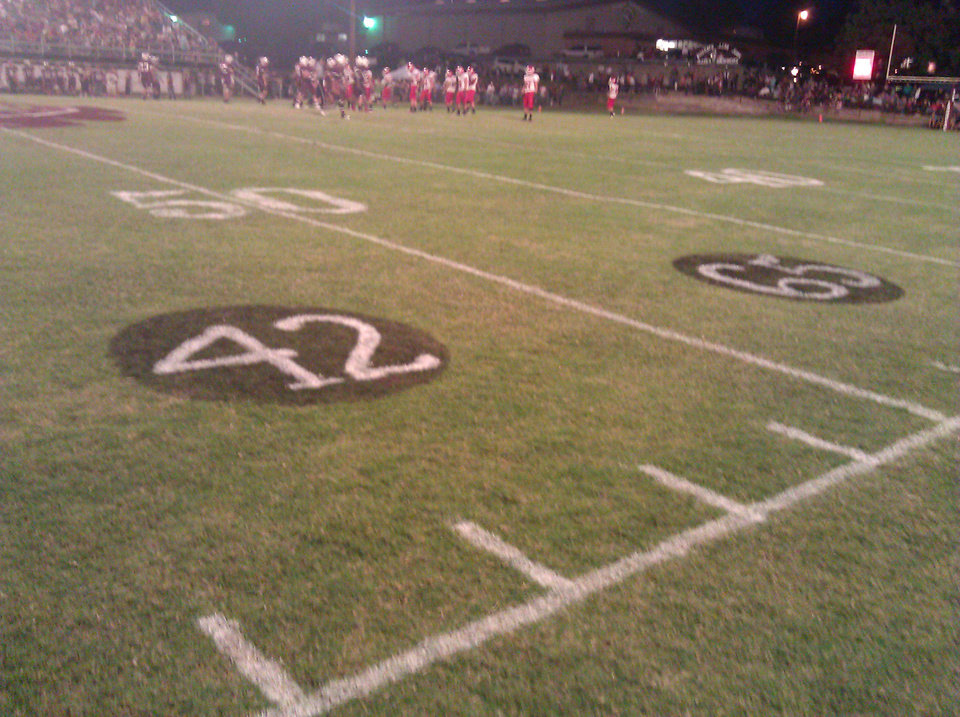 Photo - Late Stigler players Gordon Parsons' No. 42 and Cory Casinger's No. 65 were painted on Eufaula's field for the Stigler-Eufaula game on Sept. 28, 2012. PHOTO BY RYAN ABER, THE OKLAHOMAN