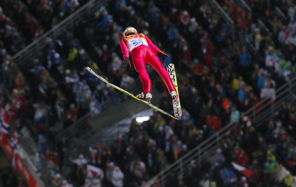 Photo - Poland's Kamil Stoch makes his first attempt during the ski jumping large hill final at the 2014 Winter Olympics, Saturday, Feb. 15, 2014, in Krasnaya Polyana, Russia. (AP Photo/Dmitry Lovetsky)