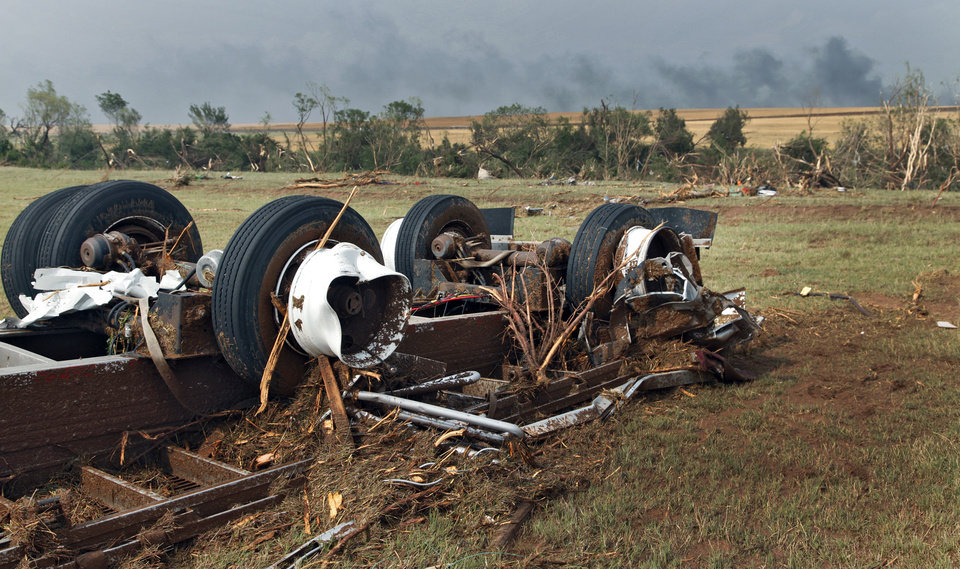 Photo - A tractor trailer that was destroyed by a tornado west of El Reno, Tuesday, May 24, 2011. Photo by Chris Landsberger, The Oklahoman