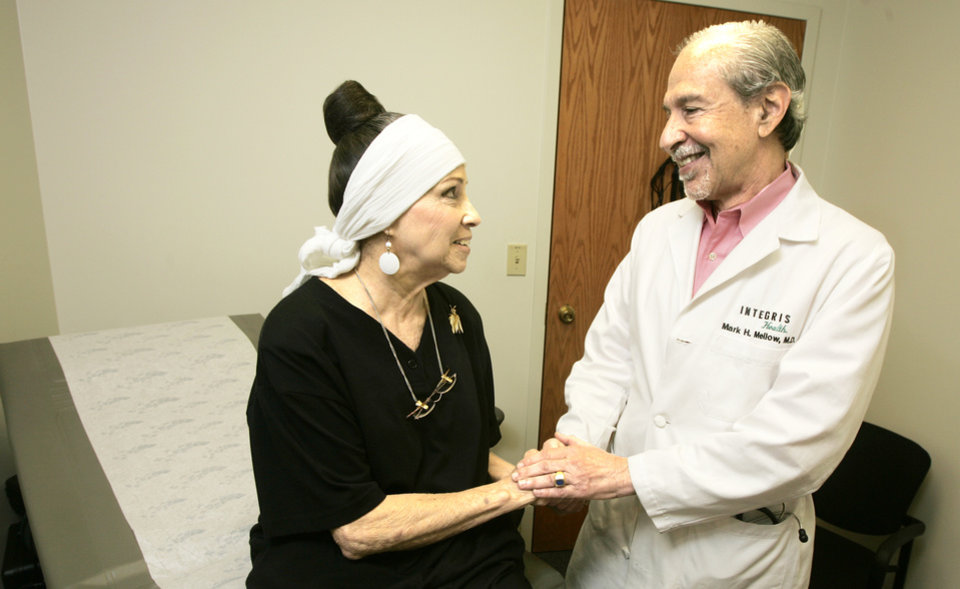 Photo - Dr. Mark  Mellow talks with fecal transplant patient  Lorraine Rettig during her follow-up  consultation  at Integris Baptist  Medical  Center.   PHOTO BY  Steve Gooch,  The Oklahoman