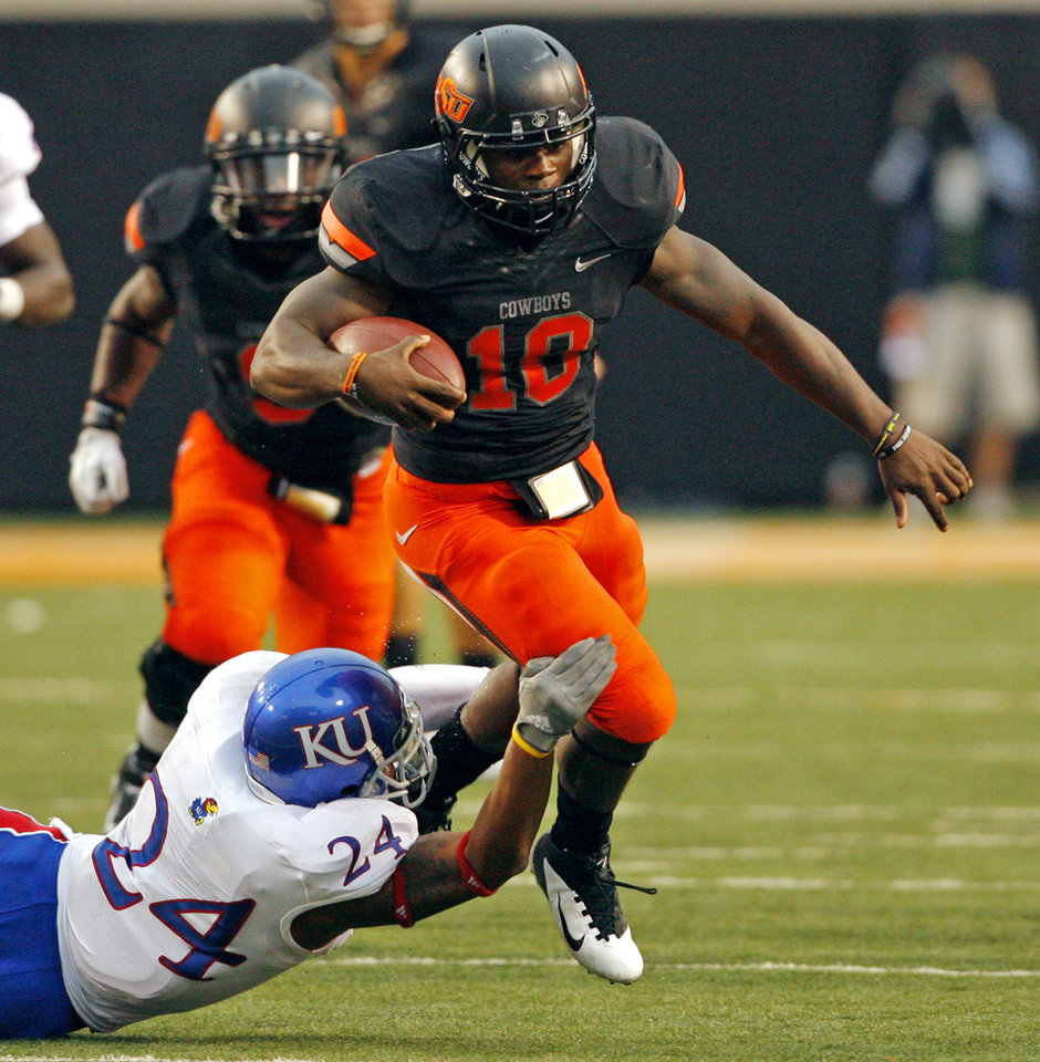 Photo - Oklahoma State's Elliott Jeffcoat (18) runs past the tackle of Kansas' Bradley McDougald (24) during the second half of a college football game where the Oklahoma State University Cowboys (OSU) defeated the University of Kansas Jayhawks (KU) 70-28 at Boone Pickens Stadium in Stillwater, Okla., Saturday, Oct. 8, 2011 Photo by Steve Sisney, The Oklahoman