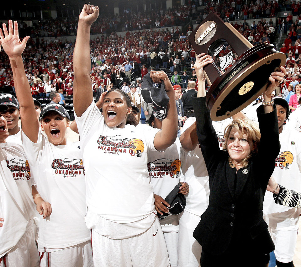 Photo - OU's Sherri Coale, right, Courtney Paris, and Jenny Vining after their win in the NCAA women's basketball regional  tournament finals between Oklahoma and Purdue at the Ford Center in Oklahoma City, Tuesday, March 30, 2009.  OU won 74-68. Photo by Bryan Terry, The Oklahoman ORG XMIT: KOD