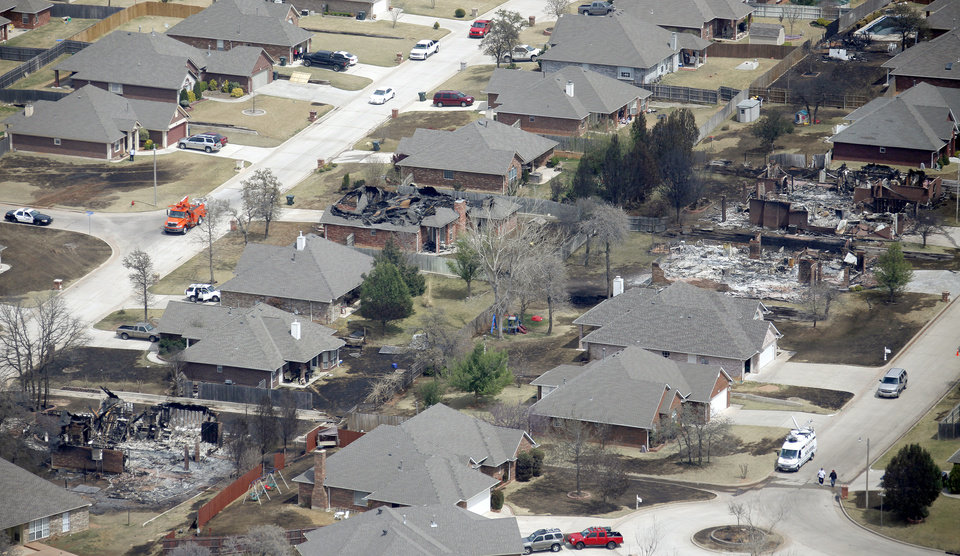 Burned houses in the Oakwood East Royale in Midwest City, Friday, April 10, 2009. Photo by Bryan Terry, The Oklahoman