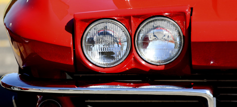 Photo - The headlight of a 1964 Chevrolet Corvette on display at Frontier Chevrolet in El Reno, Monday August  25, 2014. Corvette enthusiast made a stop in El Reno on their cross country trip in a National Corvette Caravan.  Photo By Steve Gooch, The Oklahoman